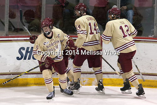 Michael Matheson (BC - 5), Adam Gilmour (BC - 14), Alex Tuch (BC - 12) - The Boston College Eagles defeated the visiting University of Michigan Wolverines 5-1 (EN) on Saturday, December 13, 2014, at Kelley Rink in Conte Forum in Chestnut Hill, Massachusetts.