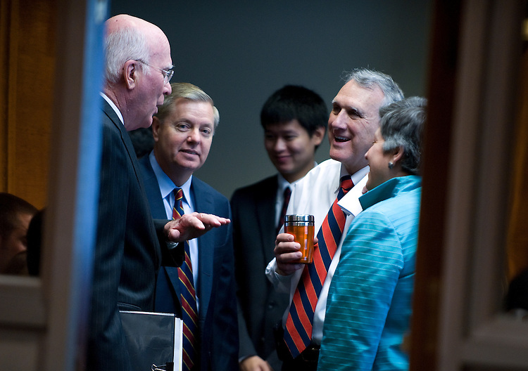 Chairman Patrick Leahy, D-VT., Lindsey Graham, R-Sc., Jon Kyl, R-AZ., and Homeland Security Secretary Janet Napolitano talk in a back meeting room before the start of the full committee hearing on Oversight of the Homeland Security Department, in the Dirksen Senate Office Building on April 27,2010..