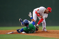 Second baseman Yoan Moncada (24) of the Greenville Drive applies the late tag on Chase Vallot (15) of the Lexington Legends on Monday, May 18, 2015, at Fluor Field at the West End in Greenville, South Carolina. Moncada, a 19-year-old prospect from Cuba, made his professional debut tonight in the Red Sox organization. (Tom Priddy/Four Seam Images)