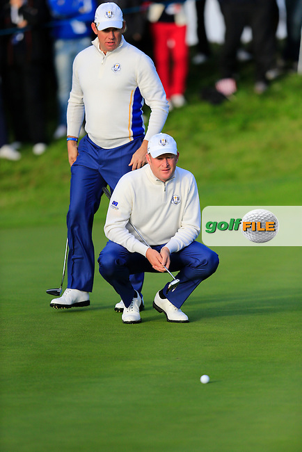 Lee Westwood and Jamie Donaldson (EUR) lines up their putt on the 3rd green during Saturday Morning's Fourball Matches between Europe's Lee Westwood and Jamie Donaldson and USA's Hunter Mahan and Jim Furyk of the Ryder Cup 2014 played on the PGA Centenary Course at the Gleneagles Hotel, Auchterarder, Scotland.: Picture Eoin Clarke, www.golffile.ie: 27th September 2014