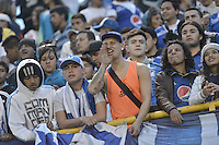 PASTO -COLOMBIA, 12-07-2015: Hinchas de Millonarios corean a su equipo durante el encuentro entre Deportivo Pasto y Millonarios por la primera fecha de la Liga Águila II 2015 jugado en el estadio La Libertad de la ciudad de Pasto./ Fans of Millonarios cheer their team during the match between Deportivo Pasto and Millonarios in the match for the first date of the Aguila League II 2015 played at La Libertad stadium in Pasto city. Photo: VizzorImage / Gabriel Aponte / Staff