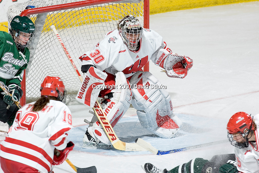 MADISON, WI - FEBRUARY 16: Goalie Jesse Vetter #3o of the Wisconsin Badgers women's hockey team defends against the Bemidji State Beavers at the Kohl Center on February 16, 2007 in Madison, Wisconsin. The Badgers beat the Beavers 2-0. (Photo by David Stluka)