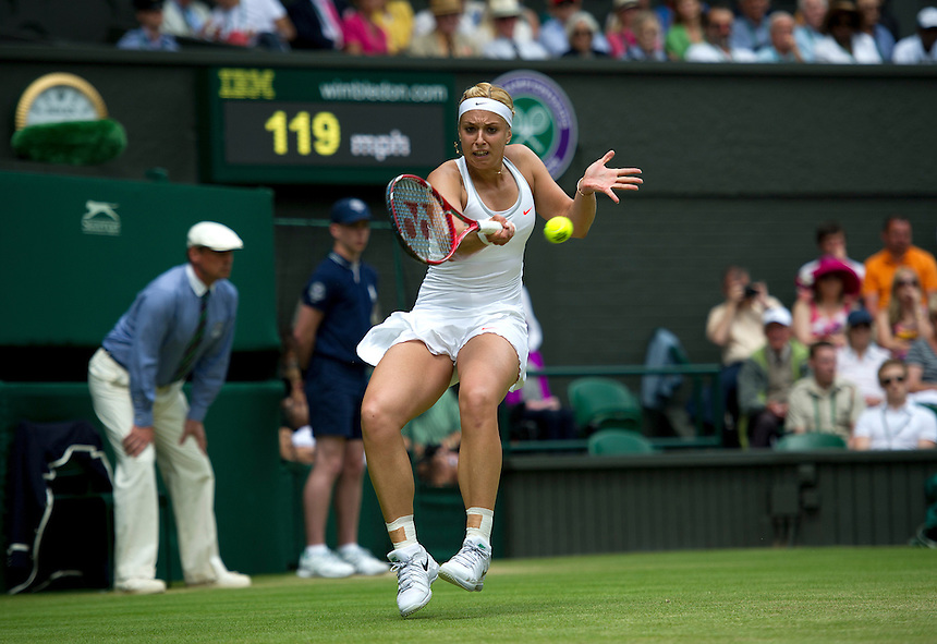 Sabine Lisicki (GER) in action during her victory over Serena Williams (USA) in their Ladies' Singles Fourth Round match today - Sabine Lisicki (GER) [23] def Serena Williams (USA) [1] 6-2 1-6 6-4<br /> <br />  (Photo by Stephen White/CameraSport) <br /> <br /> Tennis - Wimbledon Lawn Tennis Championships - Day 7 Monday 1st July 2013 -  All England Lawn Tennis and Croquet Club - Wimbledon - London - England<br /> <br /> &copy; CameraSport - 43 Linden Ave. Countesthorpe. Leicester. England. LE8 5PG - Tel: +44 (0) 116 277 4147 - admin@camerasport.com - www.camerasport.com.
