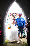 "© Joel Goodman - 07973 332324. 06/08/2017 . Macclesfield , UK . Wedding ceremony for Debbie and Andrew Tideswell , 47 and 56 respectively, from Northwich, ""officiated"" by ""Revd Duncan Pritchard"" at an inflatable church at the Rewind Festival , celebrating 1980s music and culture , at Capesthorne Hall in Siddington . Photo credit : Joel Goodman"