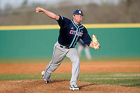 Pitcher Brett Tompkins (12) of the Citadel delivers in a game against the University of South Carolina Upstate Spartans on Tuesday, February, 18, 2014, at Cleveland S. Harley Park in Spartanburg, South Carolina. Upstate won, 6-2. (Tom Priddy/Four Seam Images)