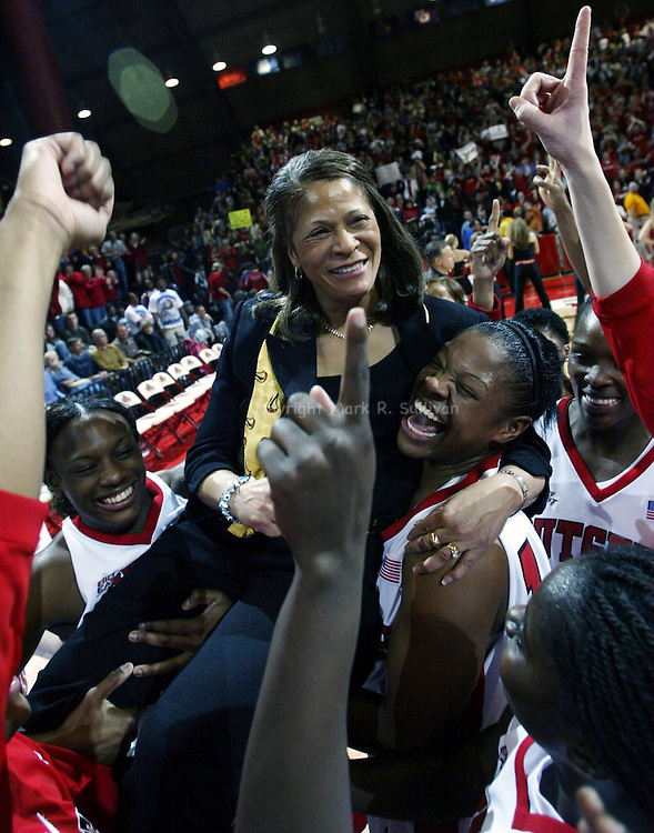 Rutgers Head women's Basketball coach C. Vivian Stringer is carried on the shoulders of her players across the floor of the Louis Brown Athletic Center in Piscataway after Rutgers beats U Conn 48-42 on Mon Feb 27,2006 (MARK R SULLIVAN)