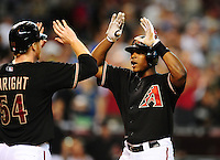 Aug. 21, 2010; Phoenix, AZ, USA; Arizona Diamondbacks outfielder Justin Upton (right) is congratulated by pitcher Barry Enright after hitting a two run home run in the sixth inning against the Colorado Rockies at Chase Field. Mandatory Credit: Mark J. Rebilas-