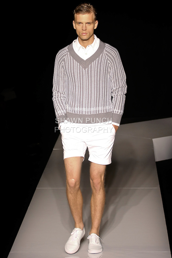 Benjamin walks runway in a grey and white cotton hand knit v-neck sweaater, white cotton pique polo shirt, white cotton short, and ivory coated braided belt, from the Joseph Abboud Spring Summer 2013 fashion show, during New York Fashion Week Spring 2013.