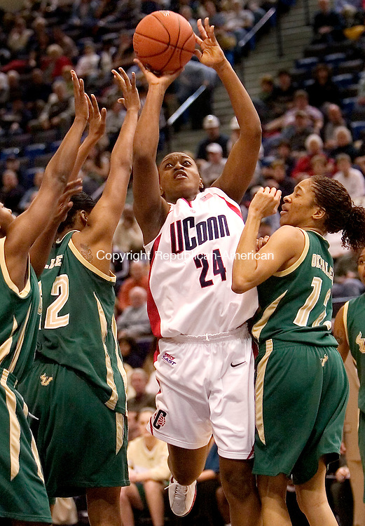 HARTFORD, CT. 04 March 2007-030407SV08--#24 Charde Houston of UConn makes a shot as # 5 Tristen Webb, #32 Nalini Miller and #12 ChiChi Okpaleke of South Florida defend during Big East basketball tournament action at the Hartford Civic Center in Hartford Sunday.<br /> Steven Valenti Republican-American
