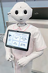 SoftBank's humanoid robot Pepper shows a human health check application through its monitor during SoftBank Robot World 2017 on November 21, 2017, Tokyo, Japan. SoftBank Robotics organized SoftBank Robot World 2017 to introduce AI (Artificial Intelligence) and IoT (the Internet of Things) companies developing the latest technology for robots, including applications its humanoid robot Pepper in various business fields. The robot expo runs until November 22. (Photo by Rodrigo Reyes Marin/AFLO)