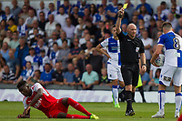 Ollie Clarke of Bristol Rovers is shown a yellow card for his challenge on Devante Cole of Fleetwood Town during the Sky Bet League 1 match between Bristol Rovers and Fleetwood Town at the Memorial Stadium, Bristol, England on 26 August 2017. Photo by Mark  Hawkins.