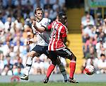 Tottenham's Eric Dier tussles with Southampton's Cuco Martina during the Barclays Premier League match at the White Hart Lane Stadium.  Photo credit should read: David Klein/Sportimage