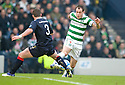CELTIC'S ANTHONY STOKES TRIES TO GO PAST FALKIRK'S TAM SCOBBIE