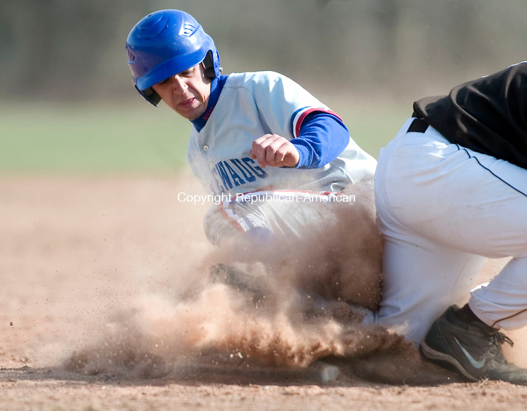 WOODBURY, CT- 11 APRIL 07- 041107JT14- <br /> Nonnewaug's Spencer Eriksen slides safely to third and then advances to home as the ball skips past Thomaston's Ben Yaffe at Wednesday's game at Nonnewaug.<br /> Josalee Thrift Republican-American