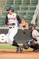 Jose Vargas #13 of the Kannapolis Intimidators follows through on his swing against the Hagerstown Suns at Fieldcrest Cannon Stadium August 10, 2010, in Kannapolis, North Carolina.  Photo by Brian Westerholt / Four Seam Images