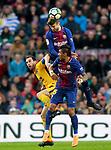 FC Barcelona's Gerard Pique (c) and Paulinho Bezerra (r) and Atletico de Madrid's Diego Godin during La Liga match. March 4,2018. (ALTERPHOTOS/Acero)