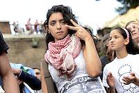 Roma 26 Luglio 2014<br /> Colosseo<br /> Presidio in solidariet&agrave; alla resistenza del popolo palestinese e contro l'offensiva militare israeliana nella Striscia di Gaza.<br /> La  protesta organizzata dalla comunit&agrave; dellee dei giovani palestinesi, &egrave; in concomitanza in tutta Europa e Mondo.<br /> Ragazza palestinese.<br /> Rome July 26, 2014 <br /> Protest in solidarity with the resistance of the Palestinian people, and against the Israeli military offensive in the Gaza Strip.<br /> The protest was organized by the Palestinian youth, is at the same time throughout Europe and the World .
