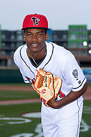 Lansing Lugnuts pitcher Juan De Paula (29) poses for a photo before a Midwest League game against the Wisconsin Timber Rattlers at Cooley Law School Stadium on May 2, 2019 in Lansing, Michigan. (Zachary Lucy/Four Seam Images)