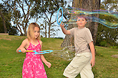 Stock photo of children playing with  bubbles
