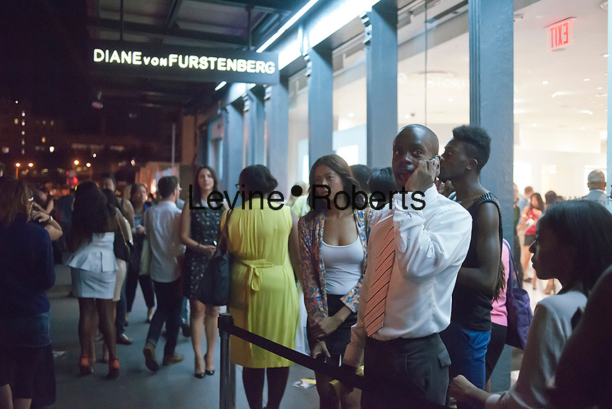 Hordes of shoppers on line outside the Diane von Furstenberg store the trendy Meatpacking District in New York on Thursday, September 6, 2012 during the fourth annual Fashion's Night Out event. On the first evening of New York Fashion Week stores around the city offer sales and bargains as well as parties and events to entice customers to shop. The event has been so successful in boosting sales that over 100 cities in the US are having their own events, and Fashion's Night Out events occur in fashion-forward cities around the world. (© Richard B. Levine)