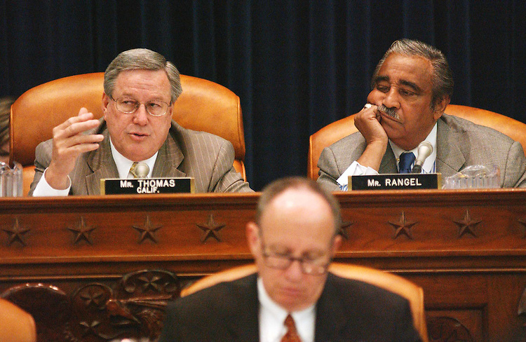"4/3/03.ENERGY TAX POLICY ACT--Chairman Bill Thomas, R-Calif., and ranking Democrat Charles B. Rangel, N.Y., during the House Ways & Means markup of HR 1531, the ""Energy Tax Policy Act of 2003."" Rep. Kevin Brady, R-Texas, is in foreground..CONGRESSIONAL QUARTERLY PHOTO BY SCOTT J. FERRELL"