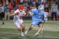 College Park, MD - April 27, 2019: John Hopkins Bluejays attack Forry Smith (4) holds off Maryland Terrapins midfielder Roman Puglise (8)  during the game between John Hopkins and Maryland at  Capital One Field at Maryland Stadium in College Park, MD.  (Photo by Elliott Brown/Media Images International)