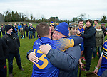 Newmarket player Colin Ryan is congratulated by his uncle Christy following their win over Sixmilebridge in the Clare Champion Cup final at Clonlara. Photograph by John Kelly.