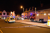 Firefighters and Police attend RTC involving an Audi A4 in collision with the front of a private house Warwickshire UK. This image may only be used to portray the subject in a positive manner..©shoutpictures.com..john@shoutpictures.com