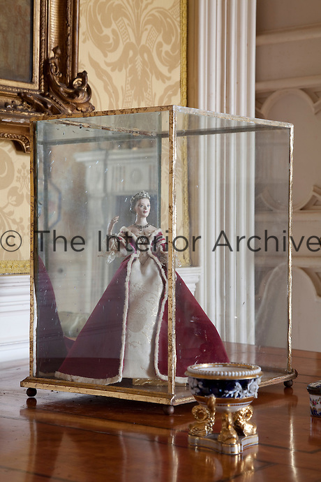 A costumed model on display in the drawing room