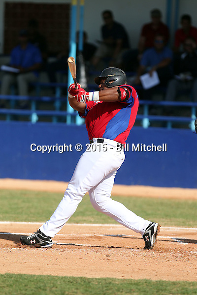 Lerys Aguilera works out at the Dominican Republic air force base in front of 100+ Major League Baseball scouts prior to being declared eligible to sign since defecting from his native Cuba in Santo Domingo, Dominican Republic on February 11, 2015 (Bill Mitchell)