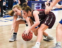 NWA Democrat-Gazette/CHARLIE KAIJO Rogers High School guard Camiran Brockhoff (3) and Siloam Springs High School Chloe Price (4) fight for possession, during the Great 8 Tournament, Thursday, November 29, 2018 at King Arena at Rogers High School in Rogers.