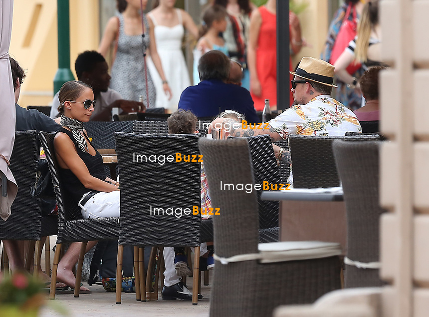 EXCLUSIVE- July 22, 2013 - Nicole Richie and Joel Madden enjoying their vacation in the south of France aboard the &quot; Alibi &quot; yacht.<br /> Luxury motor yacht Alibi&iacute; is a custom 51m / 167' 3&quot; four deck yacht which was built by CBI Navi in 2005,  providing excellent interior spaces and accommodation for 12 guests.<br /> Rented at the price of 200.000 euros/week, the couple has been traveling in the mediterranean coast between Corsica, Saint Tropez and Nice.<br /> Pictured : Nicole Richie, Jo&ecirc;l Madden and kids Harlow Winter Kate Madden &amp; Sparrow James Midnight Madden in Saint Tropez.