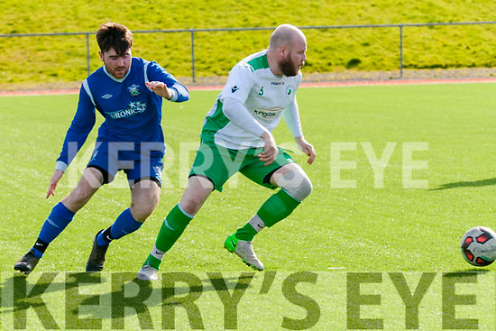 James o'Mahony (Tralee United) in action with Mark Griffin (Killarney Ath) in the greyhound Cup at Mounthawk Park,Tralee on Sunday.