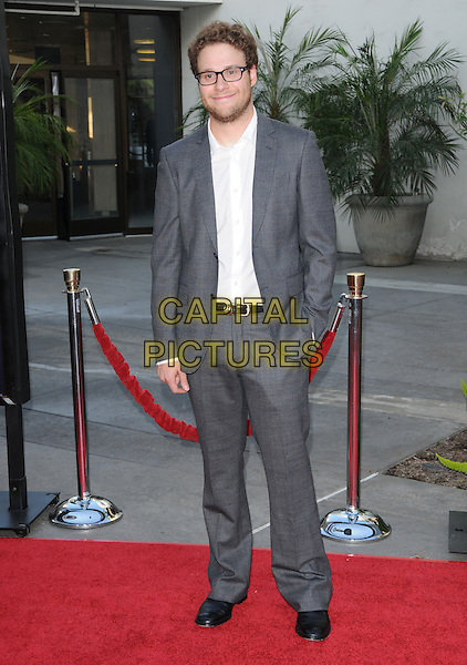 "SETH ROGEN.The Universal Pictures' Premiere of ""Funny People"" held at The Arclight Theatre in Hollywood, California, USA..July 20th, 2009.full length grey gray suit jacket hand in pocket glasses stubble beard facial hair.CAP/DVS.©Debbie VanStory/Capital Pictures."