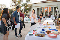 Occidental College student Miri Ha '16 shares her InternLA experience working at South LA Health Projects during the Career Development Center's Reverse Career Fair, Thorne Hall patio, Sept. 3, 2015.<br /> (Photo by Marc Campos, Occidental College Photographer)