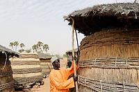 NIGER Zinder, village Zongon Soumaguela, millet storage as drought and famine protection / NIGER Zinder, Erntespeicher mit Hirse im Dorf Zongon Soumaguela, oft reichen die Speicher fuer die lange Duerreperiode nicht aus und es droht Hungersnot