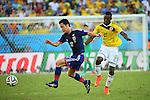 (L to R) <br /> Maya Yoshida (JPN), <br /> Jackson Martinez (COL), <br /> JUNE 24, 2014 - Football /Soccer : <br /> 2014 FIFA World Cup Brazil <br /> Group Match -Group C- <br /> between Japan 1-4 Colombia <br /> at Arena Pantanal, Cuiaba, Brazil. <br /> (Photo by YUTAKA/AFLO SPORT)