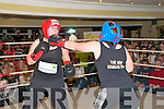 """Rumlble in Listowel : Louise Lyons take one on the chin from Marie Deenihan Carty in the eight fight at the """" Rumble in Listowel """"charity fund raising event in the Listowel Arms Hotel on Friday night last."""
