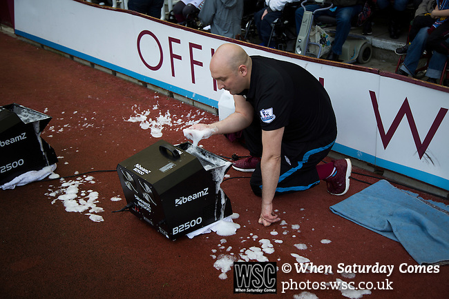 West Ham United 2 Crystal Palace 2, 02/04/2016. Boleyn Ground, Premier League. A club official clears suds from a bubble machine at the Boleyn Ground before West Ham United hosted Crystal Palace in a Barclays Premier League match. The Boleyn Ground at Upton Park was the club's home ground from 1904 until the end of the 2015-16 season when they moved into the Olympic Stadium, built for the 2012 London games, at nearby Stratford. The match ended in a 2-2 draw, watched by a near-capacity crowd of 34,857. Photo by Colin McPherson.