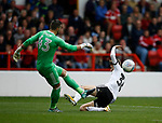 David Brooks of Sheffield Utd attempt to block a clearance by Jordan Smith of Nottingham Forest during the Championship match at the City Ground Stadium, Nottingham. Picture date 30th September 2017. Picture credit should read: Simon Bellis/Sportimage