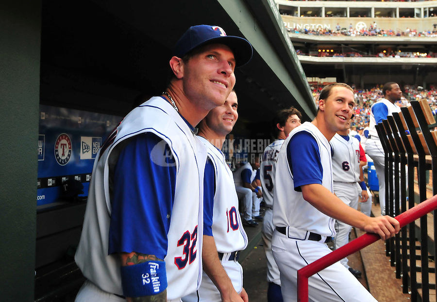 Jun. 17, 2008; Arlington, TX, USA; Texas Rangers outfielder Josh Hamilton (left) shortstop Michael Young (center) and left fielder David Murphy against the Atlanta Braves at the Rangers Ballpark. Mandatory Credit: Mark J. Rebilas-