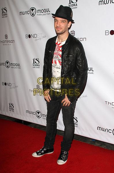 JC CHASEZ.MusicMogul.com Launch Party held at The Thompson Hotel, Beverly Hills, California, USA, 24th November 2008..full length hat beard stubble black leather jacket shoes trainers jeans .CAP/ADM/KB.©Kevan Brooks/Admedia/Capital PIctures