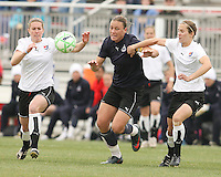 Abby Wambach (blue) of the Washington Freedom breaks past Keely Dowling and Jen Jen Buczkowski  of Sky Blue F.C. during a WPS pre season match at Maryland Soccerplex,in Boyd's, Maryland on March 14 2009. Sky Blue won the match 1-0
