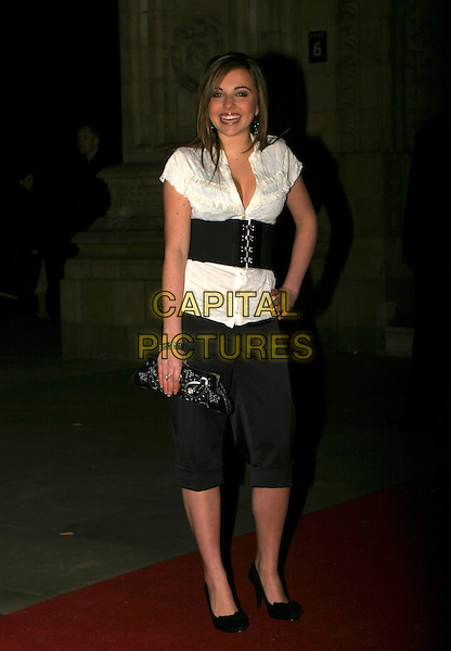 LOUISE LYTTON .Cirque Du Soleil: Alegria - press night at the Royal Albert Hall, London, UK..January 5th, 2006.Ref: AH.full length wide black belt plunging neckline white blouse shirt trousers cropped clutch purse.www.capitalpictures.com.sales@capitalpictures.com.©Capital Pictures