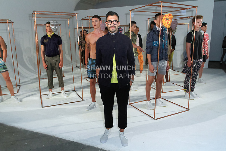 Creative Director Matteo Maniatty poses with models during his Descendant Of Thieves Spring Summer 2018 collection fashion show, for New York Mens Day at Dune Studios on July 10, 2017; duing New York Fashion Week: Mens Spring Summer 2018.