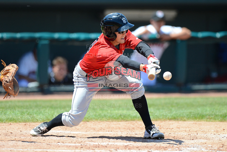 New Britain Rock Cats outfielder A.J. Pettersen #19 lays down a bunt during a game against the Erie Seawolves on June 20, 2013 at Jerry Uht Park in Erie, Pennsylvania.  New Britain defeated Erie 2-0.  (Mike Janes/Four Seam Images)