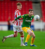 12th February 2020; Bet365 Stadium, Stoke, Staffordshire, England; English Championship Football, Stoke City versus Preston North End; Tom Barkhuizen of Preston North End has his eye on the ball as he is closed down