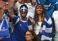 Greece fans cheer their side on