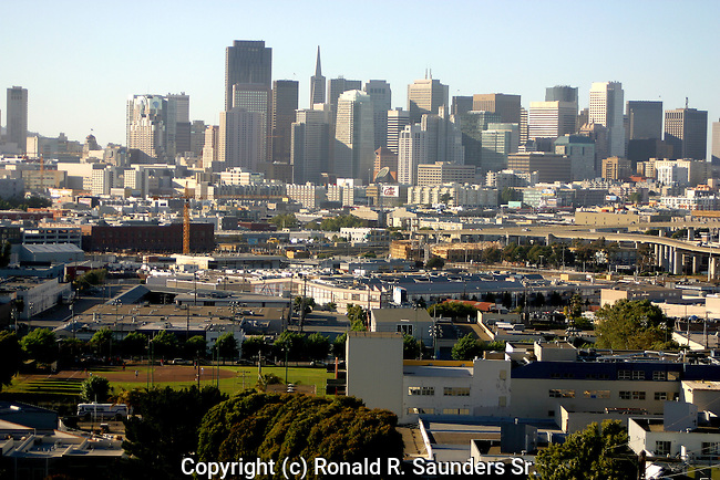 SAN FRANCISCO SKYSCRAPERS in DISTANCE and CLUSTER of OTHER STRUCTURES in FOREGROUND