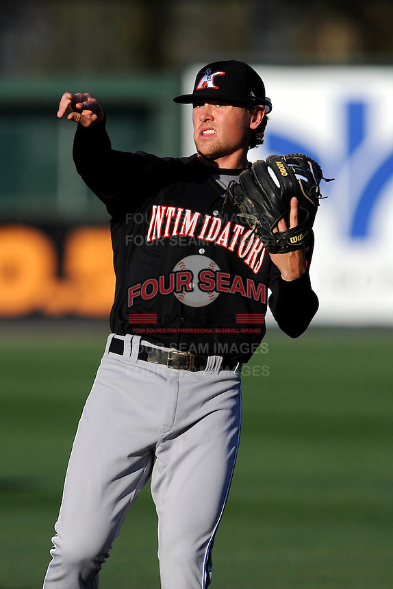 Infielder Trey Michalczewski (27) of the Kannapolis Intimidators warms up before a game against the  Greenville Drive on Thursday, April 10, 2014, at Fluor Field at the West End in Greenville, South Carolina. Michalczewski is the No. 19 prospect of the Chicago White Sox, according to Baseball America.  Greenville won, 7-6. (Tom Priddy/Four Seam Images)